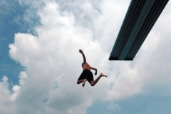 Liam Checkler, 10, of Worthington leaps from the high dive at the Worthington Pool on Dublin Granville Road last Thursday.