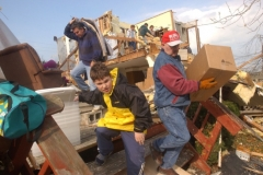 (R-L) Jim Henney, Phillip Spitler, and Steve Spitler help salvage items at Ed and Theresa Spitler's home at 3617 Northeast Catawba Road in Catawba Island Township outside of Port Clinton, Ohio.  Their home was a total loss to the storms on Sunday night. Photo Ben French The News Messenger 11/11/02