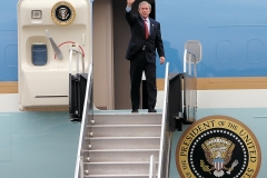 President George W. Bush waves as he exits Air Force One on Saturday at the Port Columbus International Airport during his campaign stop to Columbus.