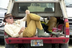 Bob Beard of Martin, Tenn, reads on the bed of his truck in the Drawbridge Marina parking lot as he waits for his charter fishing boat to arrive.  Beard is a .22 rifle coach at Camp Perry and has come to Port Clinton during the summer off and on since 1965. Photo Ben French 07/20/01