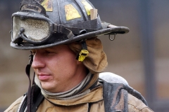 """B. Moffo of the Columbus Fire Department reflects on their training for the day at 4545 Coach Road in Upper Arlington.  The four departments worked on search and rescue training as well as """"Saving our Own"""" training."""